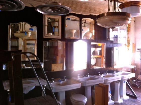 salvaged vanities bathroom sinks and lighting at
