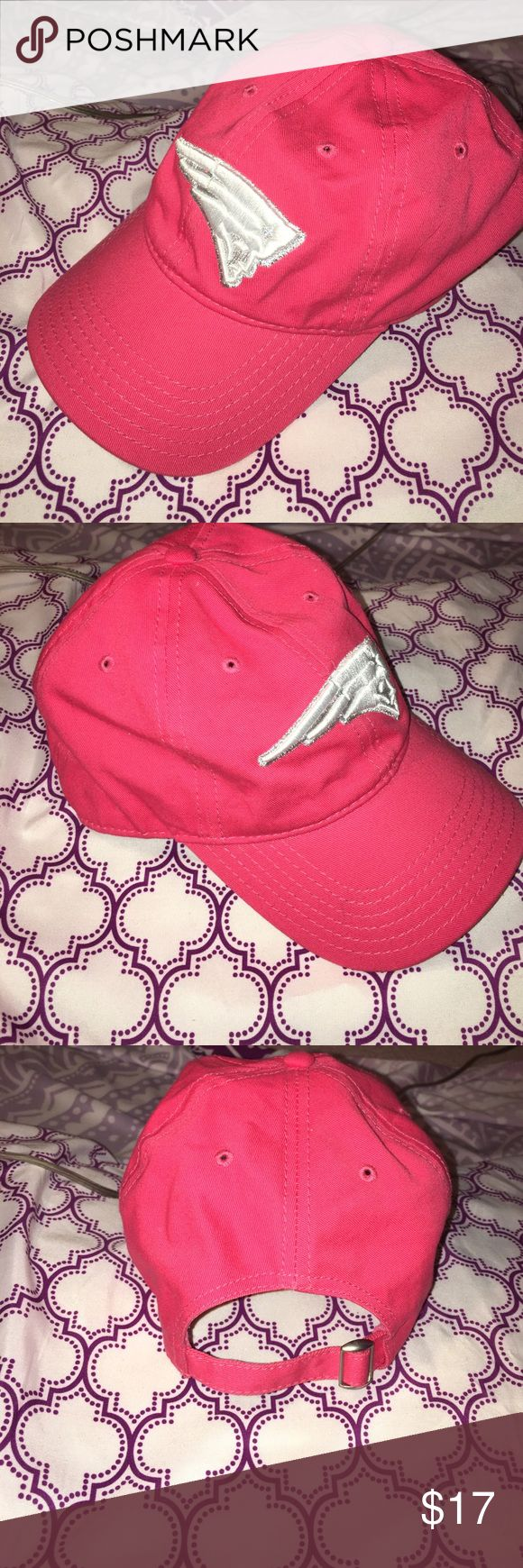 HOT PINK New England Patriots Hat. Adjustable size Perfect for the ultimate Patriots Fan that wants a feminine touch.  This is an NFL official merchandise hat 100% cotton and a one-size fits all, adjustable to fit your needs.  Received as a gift about 5 years ago and never wore it.  (Hats don't look good on me) For a bonus, this hat has a pull through spot on the back for your perfect ponytail.  True HOT PINK color with white/silver an Official Patriots logo.  Enjoy while you're cheering on…