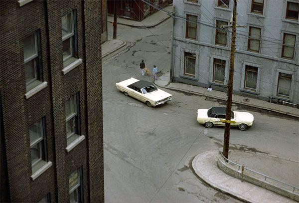 Two White Cars, Quebec City / Fred Herzog