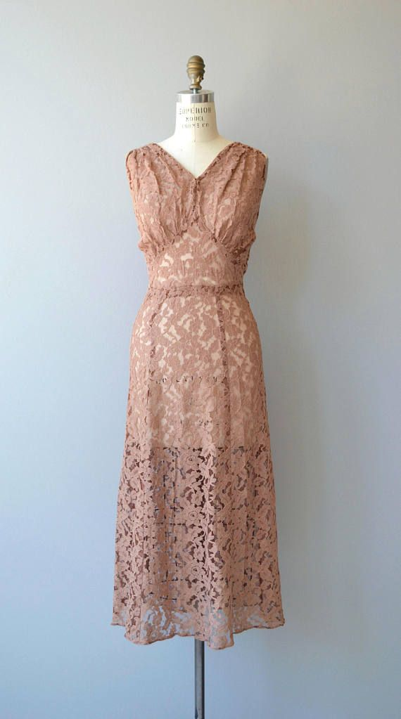 Vintage 1930s dark dusty rose lace gown with gathered bodice with inverted panel waist and seamed waist. Shown with simple ribbon belt. Sheer. --- M E A S U R E M E N T S --- fits like: medium/large bust: 38-40 waist: 32-34 shoulder to waist: 16 hip: up to 41 length: 49 brand/maker: n/a condition: a lace break at the neckline, see close up photo to ensure a good fit, please read the sizing guide: http://www.etsy.com/shop/DearGolden/policy ✩ layaway ...