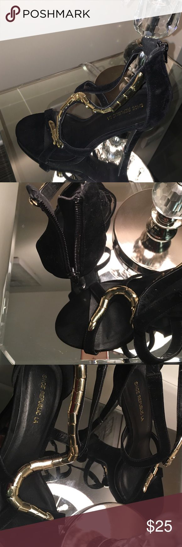 Black and Gold Strap Heels Sz. 8 Dazzle in these velvet suede black and gold strap heels. Wear on the bottom from try on in the store and the heel is 4.75 inches. Brand Shoe Republic LA and purchased at a boutique in NYC Shoes Heels