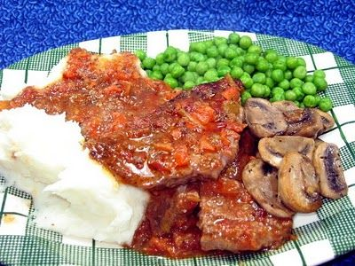 Crock Pot Swiss Steak - I have a recipe that we love, but this one sounds too good not to try.