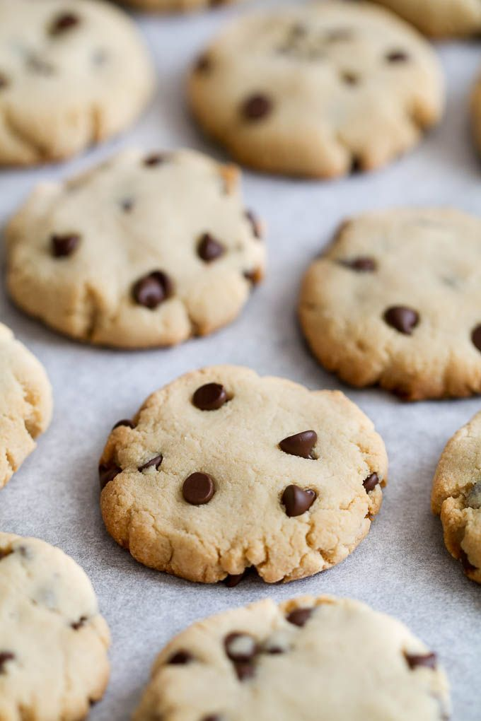 These Grain Free Vegan Chocolate Chip Cookies have the same texture and taste as a classic chocolate chip cookie, but are made without flour, butter, eggs, or refined sugar!   runningwithspoons.com #paleo #vegan #glutenfree #recipe