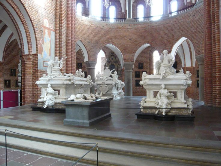 Frederick IV's sarcophagus (right) at Roskilde Cathedral
