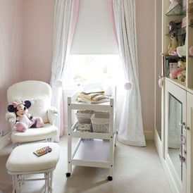 3 pretty elements: curtains banded with pale pink, pink curtain tiebacks & simple Roman blind in this girls bedroom