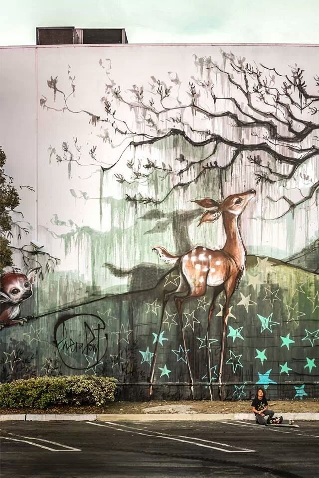 """Herakut is the name of a two-person team of German street artists specializing in murals. Jasmin Siddiqui, or """"Hera"""" and Falk Lehman """"Akut""""."""