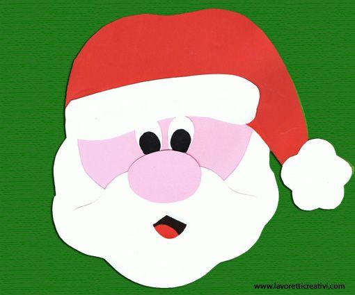 Per le decorazioni di Natale non può mancare la faccia simpatica di Babbo Natale. Se volete la potete realizzare facilmente con dei cartoncini colorati. Un