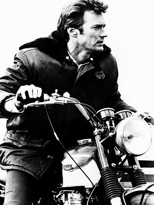 Clint Eastwood driving his Triumph motorcycle during the filming of Where Eagles Dare, 1968.