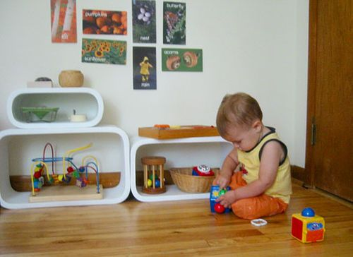 These shelves are pretty cool. Pictures are low at the child's eye level.