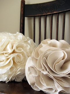 Great tutorial for fabric poms. I'm thinking about making these and then resting them inside some large mouth glass vases for a fabric hydrangea style look that I don't have to water!