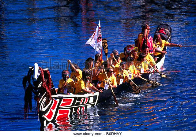 Native American Indians canoeing in a Traditional Dugout Canoe at the Indigenous Games in Victoria British Columbia Canada Stock Photo