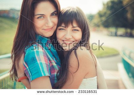 beautiful hipster young women sisters friends in the city