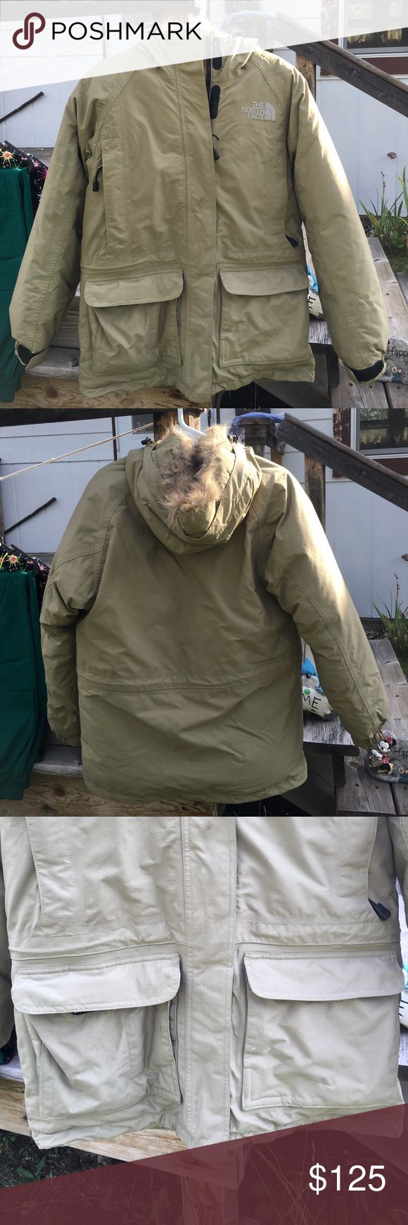 North Face Parka Jacket EUC Like New North Face Parka Jacket EUC Like New Lots of pockets Insulated Women's Regular Small Petite Made in Bangladesh Shell is 100%Nylon Lining 100% Polyester Insulation Goose Down zips up the front and have Velcro tabs for extra warmth The North Face Jackets & Coats