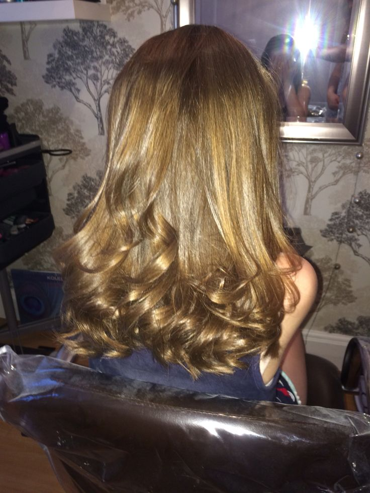 curly blow dry done by striaghters