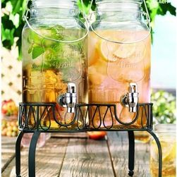 Home Essentials - Twin Mason Jar Drink Dispensers - At the beach or on the front porch, our mason jar inspired collection continued the American tradition of casual and stylish entertaining! This 2 gallon glass drink dispenser is a party workhouse that frees you up from your bartering duties so you can invite friends over for a relaxing afternoon outside on the patio. Crafted of high quality, durable glass and fashioned into the shape of a mason jar. This beverage dispenser is an established…