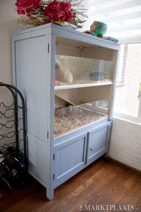 """large homemade small animal home (mice etc). Line bottom and about 2"""" up sides with linoleum flooring (waterproof for cleanup)."""