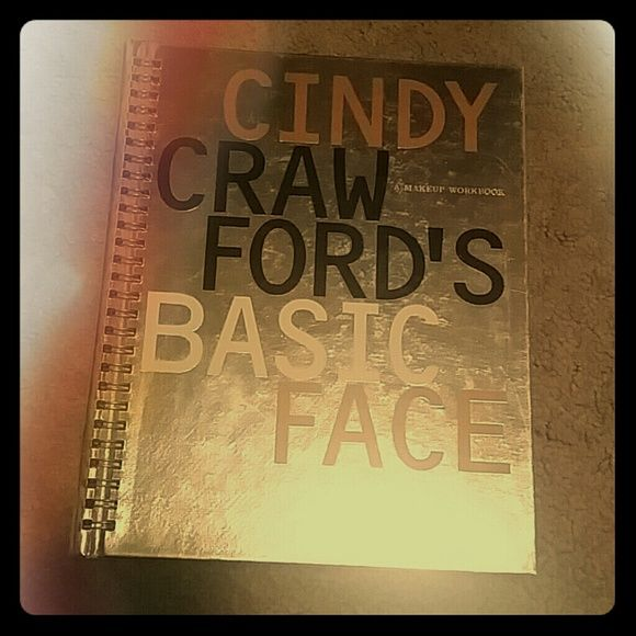 Cindy Crawford's Basic Face Rare Makeup WorkBook Makeup workbook. 107 pages of detailed info, pix, abd instructions on makeup from skin care to eyes, lips, eyebrows, contouring, blush, ect ect. Cindy Crawford Makeup