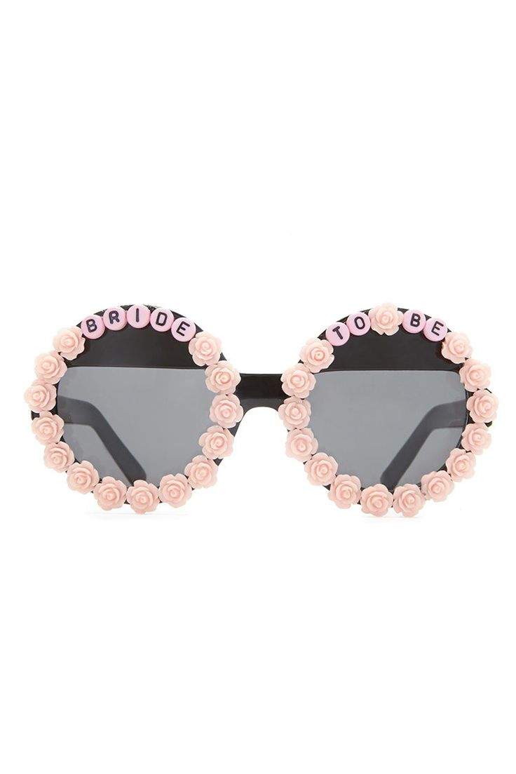 """A pair of midweight sunglasses from Rad and Refined™ featuring a round shape finished with roses and a """"Bride To Be"""" design. Not available for in-store return."""