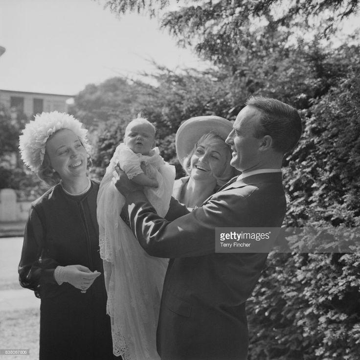 English actor Edward Woodward (1930-2000), his wife Venetia Barrett, and British actress Sheila Hancock celebrate birth of Sarah Woodward, London, UK, April 1963.