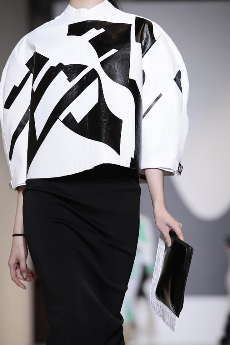 Sculptural Cocoon Jacket with 3D circular silhouette & bold monochrome surface pattern // Masha Ma SS14