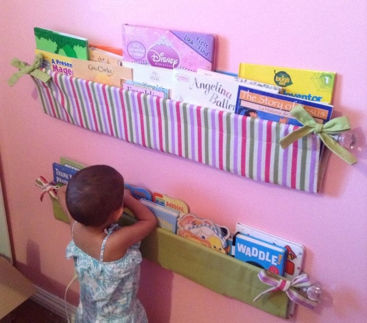 Cute handmade bookshelves! Sew pieces of fabric so that one side can fit through a curtain rod. The other side has bows sewed  to the opposite ends. Hang it from a curtain rod and tied the bows to the rod.  Voilà! Just put books in and you have a cute bookshelf! Thanks to @Priscilla Pham Estrada for the pinspiration! www.facebook.com/PriscillaEstrada?fref=ts