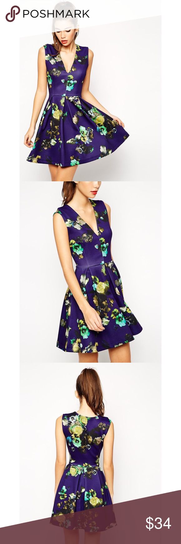 """ASOS Blue Floral Skater Mini Dress w/Pleats This gorgeous dress by ASOS is finished with subtle pleat detailing at the waist, that adds a structured effect to the silhouette. Features an allover floral print on a deep blue (almost purplish) background; 96% polyester;4% elastane; heavy material; pleated waist; deep V front; material has a lot of stretch. Approx. measurements: bust 17-19.5""""; waist 13.5-15.5""""; length 35"""". In good condition. Please ask questions before buying. NO TRADES! ASOS…"""