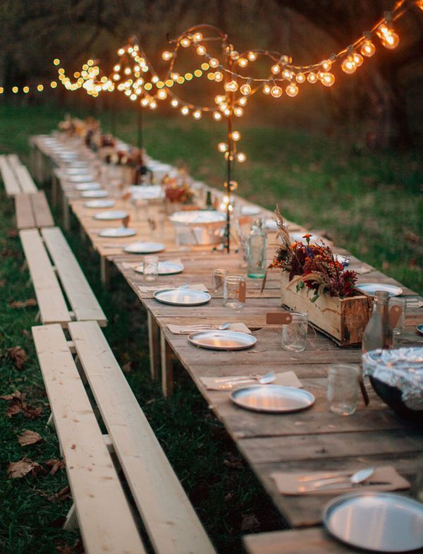 There's a lot to love about this outdoor fall reception. The idea for hanging lights from poles placed between the tables is nothing short of brilliant and the potted centerpieces are a terrific seasonal solution. On a clear autumn evening, few things are more pleasant than a meal outside with friends (just make sure to provide cozy blankets).
