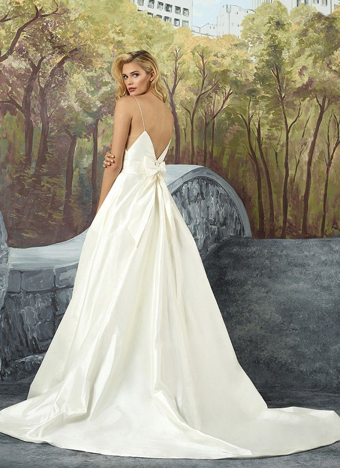 It all starts with a feeling. This dramatic Silk Dupion ball gown has a deep V-neckline, delicate spaghetti straps, deep V-back and hidden pockets. A beautiful bow on the back of the gown is the only embellishment to this simple, elegant style. https://www.justinalexanderbridal.com/wedding_dresses/8927