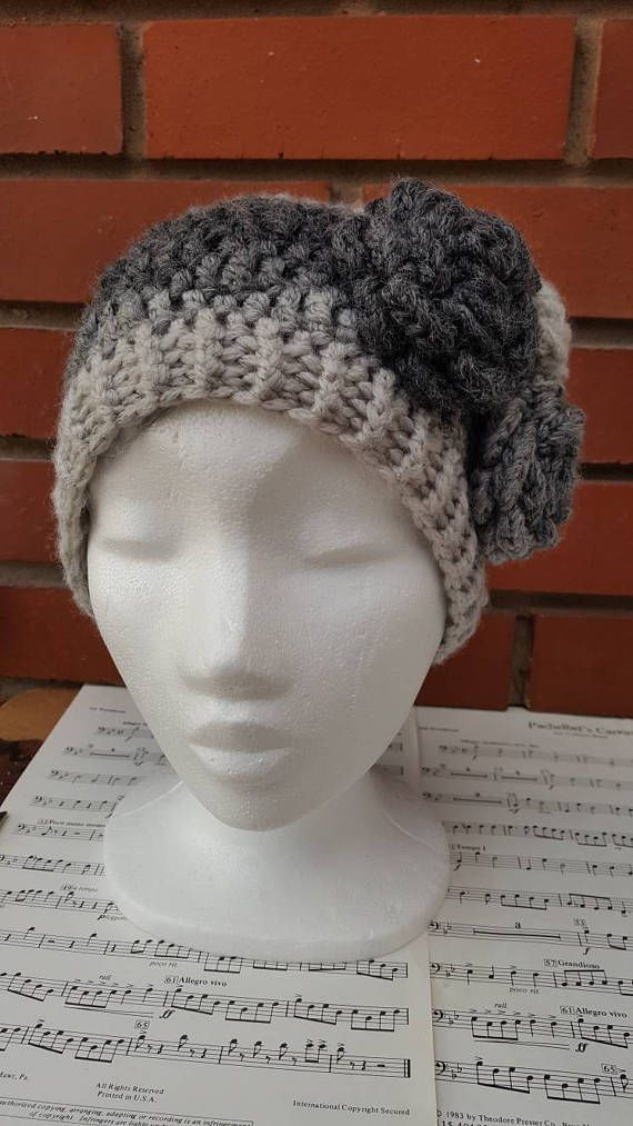 This listing is for a ready made, ready to ship ladies hat with flower details. Crocheted in soft variegated acrylic (72%), wool (18%) and nylon (10%) mix yarn, this winter hat feels soft and cosy. Due to the wool content of the yarn it is recommended to hand wash only. The size of this beanie hat would fit adults with larger heads or a lot of hair like myself! I accept custom orders of you like the design but the size or colour is not to your fancy. Just drop me a message and we can get…