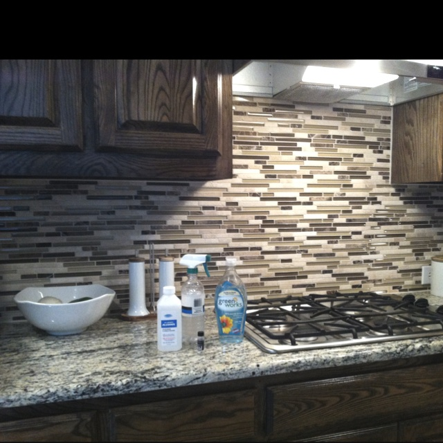 Awesome granite counter cleaner! 1/4 cup of rubbing alcohol, 3 drops of dishwashing liquid, and 1 cup of water mixed in a spray bottle. I added a few drops of vanilla oil just to make it smell nicer. :)