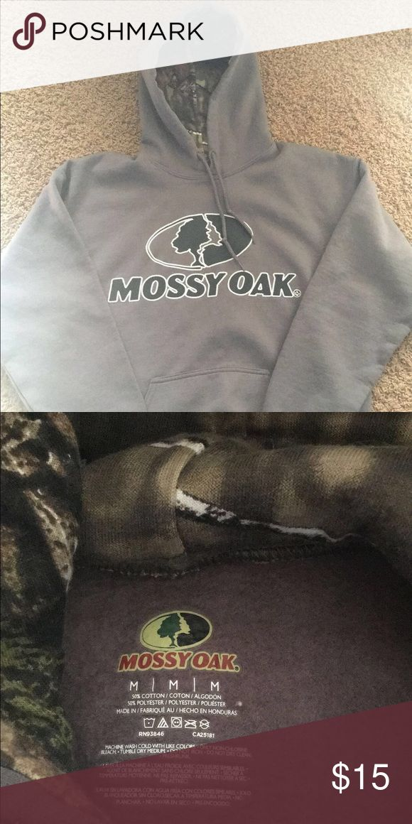 Mossy Oak Hoodie Worn once and washed but doesn't fit anymore. it's a dark grey the first picture has a glare mossy oak Other