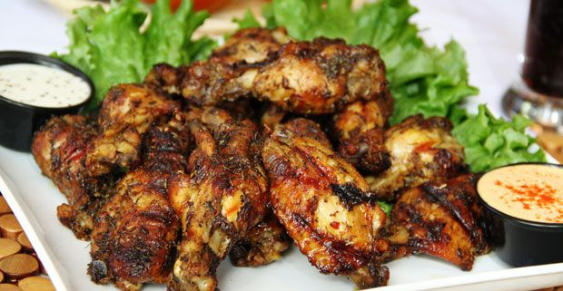 One of my favorite recipes that I learned from my college roommate from Guyana how to make jerk wings.  Her recipe was short and simple.  It includes using either Walker Woods marinade or Grace mar...
