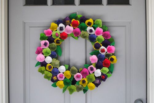 Cut egg carton apart - paint the different sections and glue to a cardboard circle. Use lid of carton to cut out flowers.