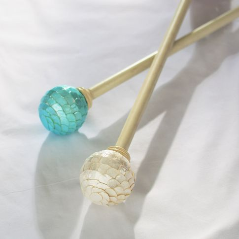 the aqua colored curtain rod end finials would look really cute with the mermaid theme I'm doing in monkey's bedroom!