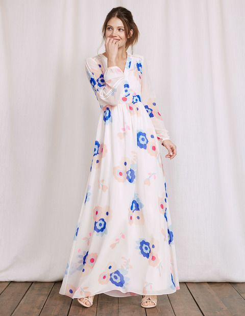 Find your free spirit and run barefoot through the cornfields (or just wow everyone at the garden party) with this floaty maxi dress. The empire line is flattering and the gathered waist creates a feminine shape. A stunning floral print and lace detail complete the Seventies feel.