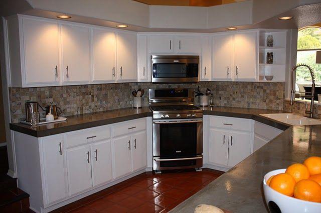 concrete counter tops, white cabinets,