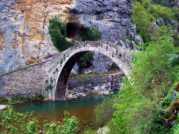 Stone Bridge #Kokkoros - This single-arched bridge stands between the impressive rocks since 1750, enabling the locals to cross the canyon of Vikos.