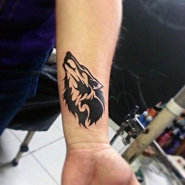 14 Small Wolf Tattoo Ideas Petpress 14 Small Wolf Tattoo Ideas Petpress Ideas Musictattooidea In 2020 Small Wolf Tattoo Wolf Tattoos Men Tribal Wolf Tattoo