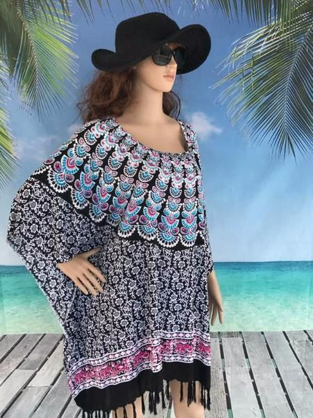 Lovely cool cotton sarong tunic tops in plus size. Beautiful elephants and deer trail around the bottom border.  The neckline design incorporates stunning peacock fans which have been lovingly enhanced by four rows of hand sewn sequins. All finished with a gorgeous floral creeping vine.  The combination presents a delightful design.