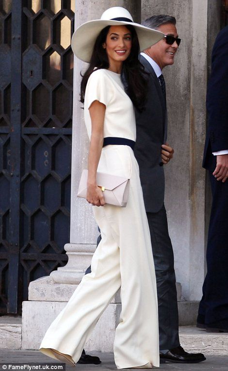 With these rings: While George showed off his wedding band, Amal's huge engagement ring was clearly visible