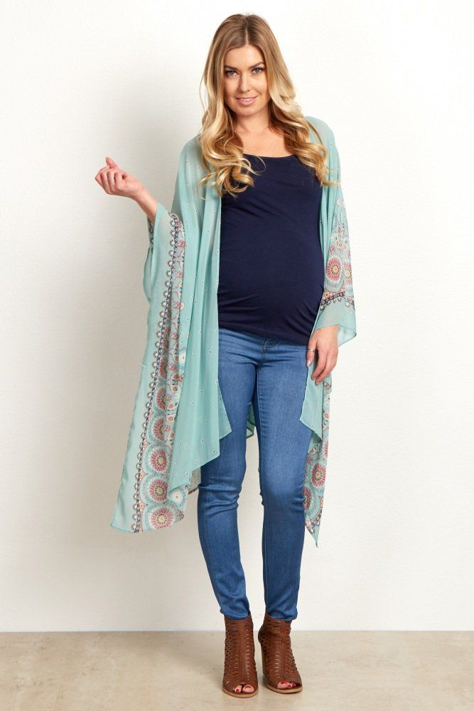 We are in love with this gorgeous maternity kimono! A flowy chiffon material with a beautiful floral print border for a long kimono that will make a statement everywhere you go. Layer this maternity kimono over a maternity cami and wear with maternity jeans and boots for a complete ensemble.