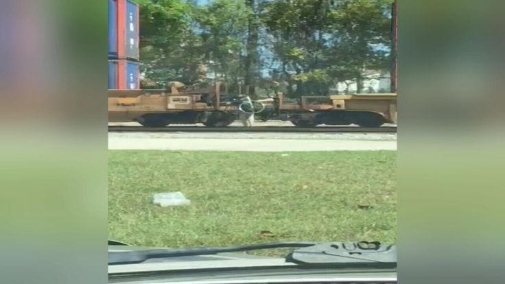 "JACKSONVILLE -- A Jimmy Johns delivery person was caught on camera  hopping on a moving train to get to the other side to make his delivery ""freaky fast,"" as the commercials say. (March 2016)"