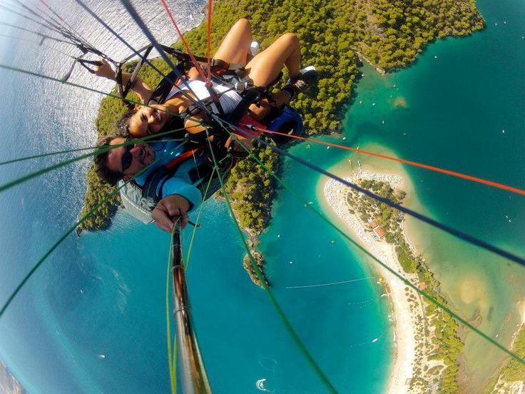 Paragliding over blue lagoon.