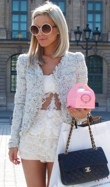 Tweed jacket worn over lace top & shorts, perfectly accessorized w/ Chanel bag