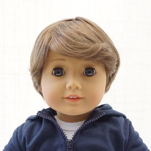 Hello world, meet Jessie!  Jessie is a brand new 18 inch American Girl Doll that has been customized by me into an adorable boy doll. He has the sweetest face! Jessie has beautiful big brown sleep eyes and light brown hair. He will make the perfect boyfriend or brother to your American Girl, Our Generation Doll or Madame Alexander Doll, or a wonderful companion for a lucky little boy!  He has only been out of his original box in my smoke-free home long enough to have his makeup and hair…