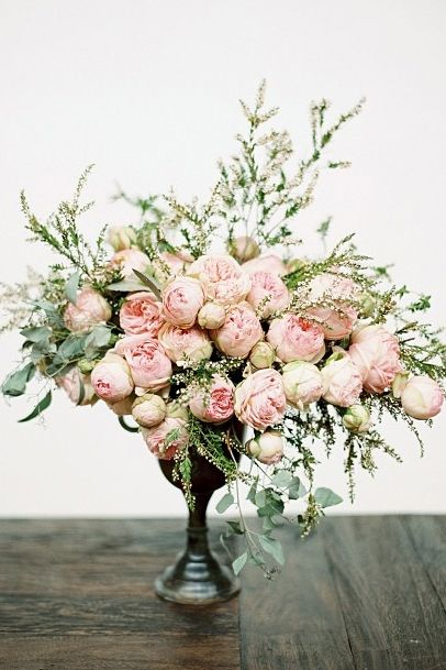 """Floral designer Jaclyn Journey took these peony-lookalikes (FYI: they're called """"Piano"""" roses) and added a bit of height with flowering branches."""