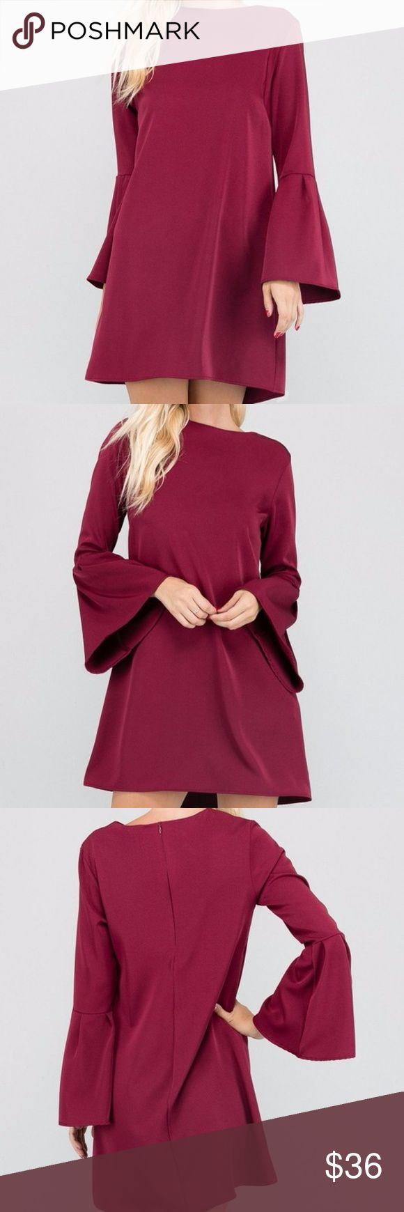 Burgundy  Bell Sleeve Mini Shift Dress Tunic Top Burgundy long Bell Sleeve mini Dress or Tunic Top. Hidden zipper back closure. Made of soft stretchy crepe fabric. Polyester spandex blend. Made in USA. Brand New factory direct.  Size S 2/4: Bust 33-34 Waist 25-26 Hips 35-36 Size M 6/8: Bust 35-36 Waist 27-28 Hips 37-38 Size L 10/12: Bust 37-38 Waist 29-30 Hips 39-40  Size chart provided as a guidance. Dresses Mini