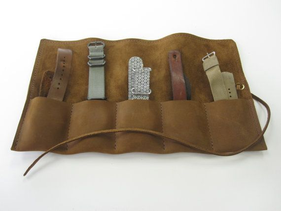 This Hammer Creek brown leather watch roll simple design will keep up to five watches safe on your travels. The roll will fit watches of