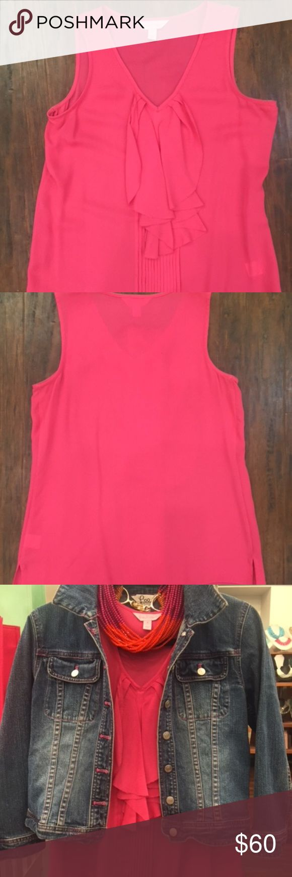 """Lilly Pulitzer, Hot Pink Sleeveless Blouse Hot Pink Blouse is Silk and has an ascot like ruffle on the front. Lightly worn. Straight hemline with small notched vents on the side.  Sleeveless blouse is 24"""" long from the top of the back neck to the hem (slightly longer in the front).  16"""" across the back under the arm holes.  Bra strap keepers under each shoulder. Lilly Pulitzer Tops Blouses"""