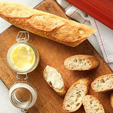 Easy Crusty Baguettes: King Arthur Flour -- a comment suggests that instead of using a stoneware baguette baker, you can use a perforated metal baguette pan and a disposable aluminum roasting pan on top. I love that this recipe doesn't take all day and it doesn't require an overnight poolish.